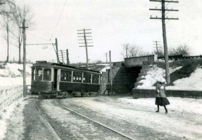 trolley and pedestrians near the Death Trap in winter