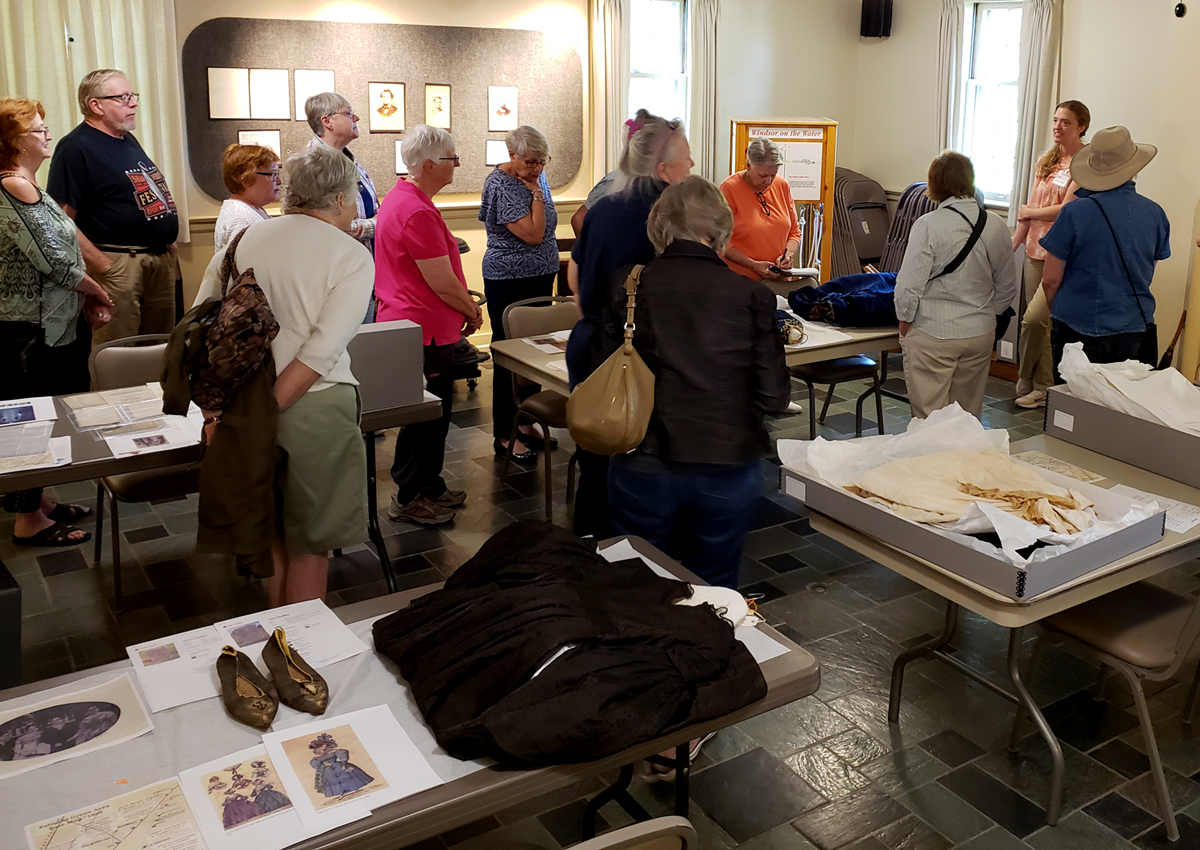 Curator Kristen Wands shows off textile collections